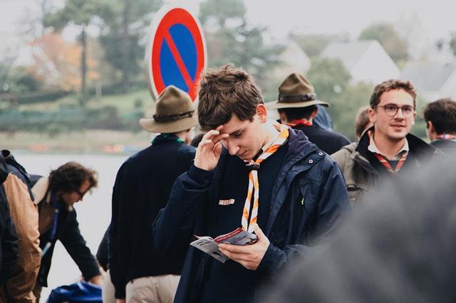 Boy holding a brochure