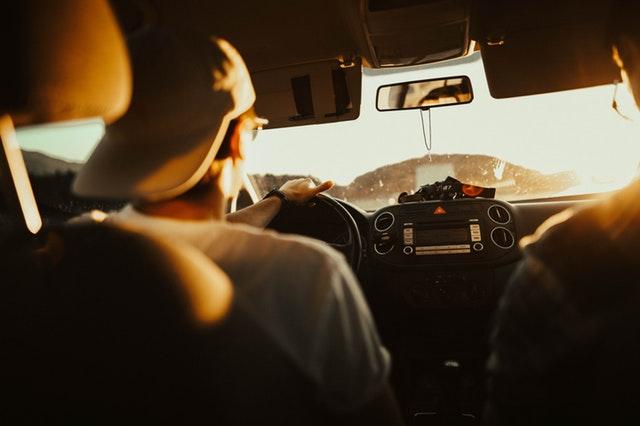 Adults in a car