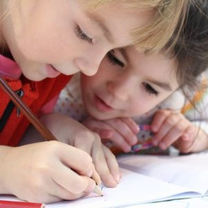 two children studying at desk