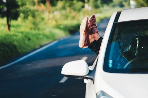 Person's leg out of the car